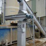 Pivoting sludge conveyor for even distribution