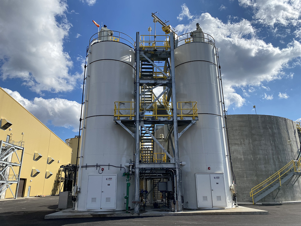 Hydrated lime dry to slurry systems